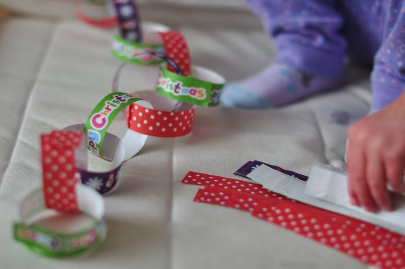 Little L making paper chains